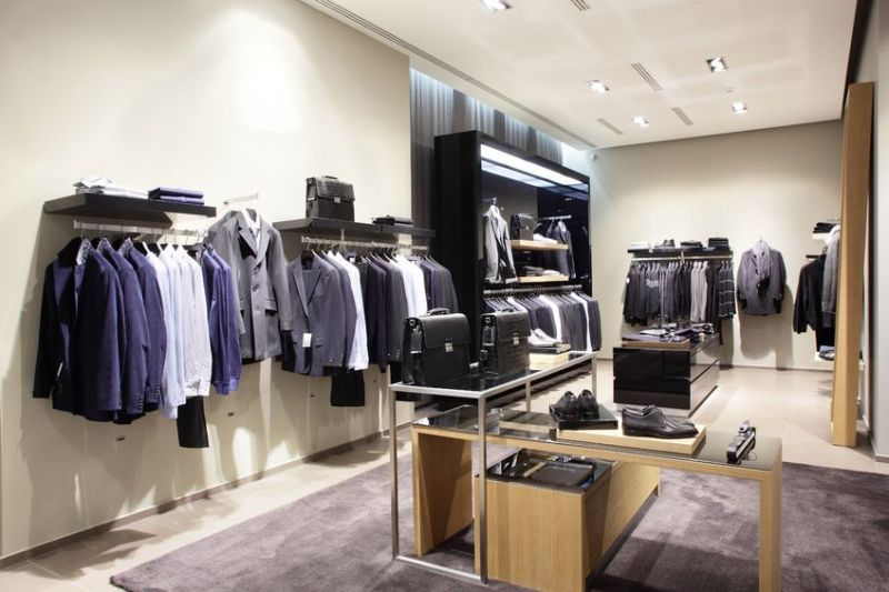 22133141 - interior of brand new fashion clothes store