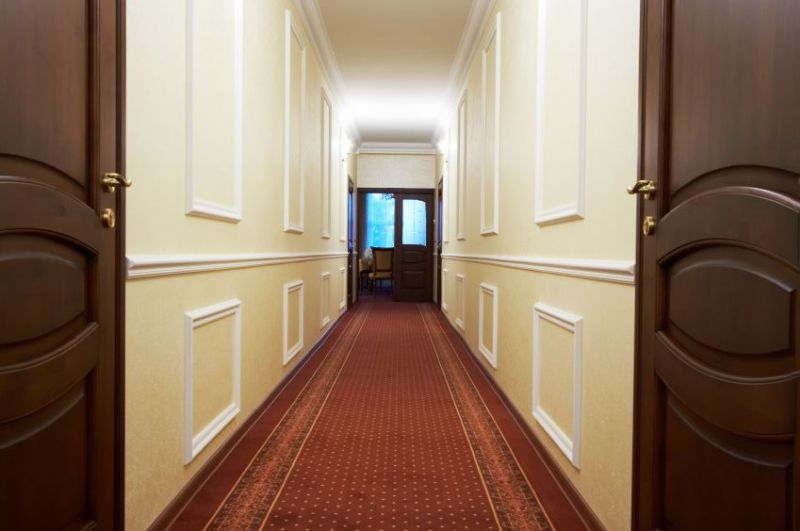 793580 - long corridor with a window in modern hotel