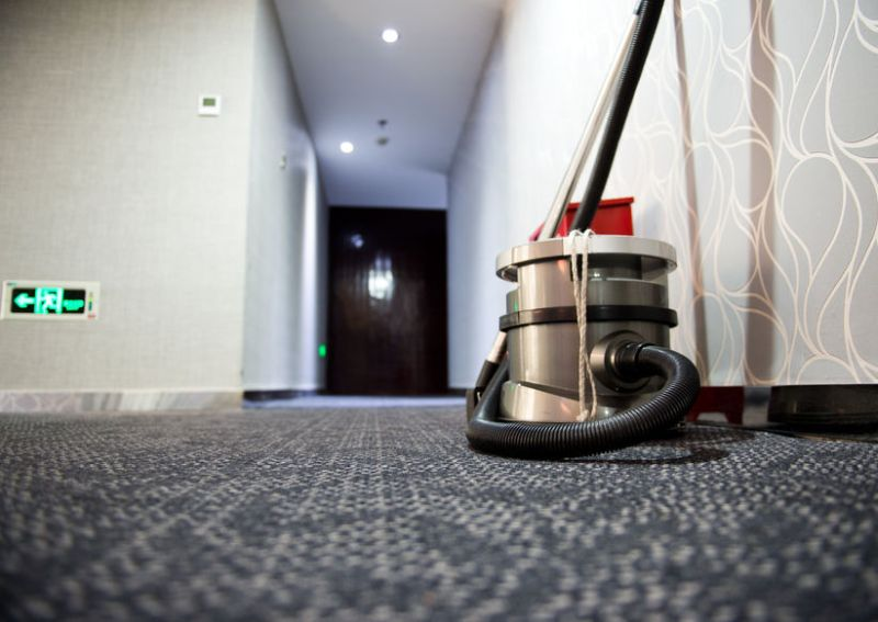 24905654 - vacuum cleaner stands in the hotel corridor.