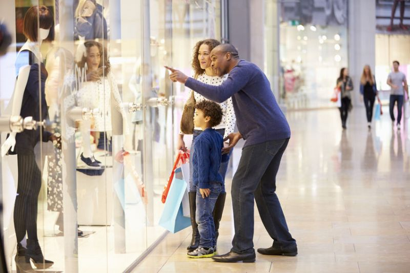 42307247 - child on trip to shopping mall with parents
