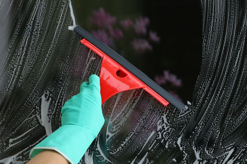 15165430 - housework with red squeegee for glass, window cleaning