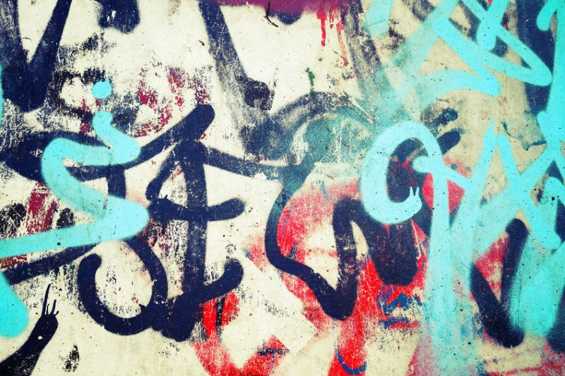 40561946 - abstract colorful graffiti patterns over old urban concrete wall, vintage tonal photo filter effect, retro style